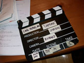 clapperboard and script